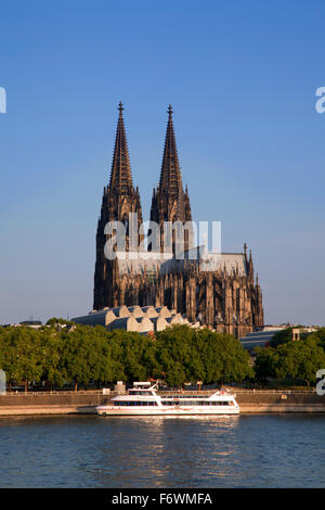 Excursion ship on the Rhine river in front of Cologne cathedral, Cologne, Rhine river, North Rhine-Westphalia, Germany - Stock Photo