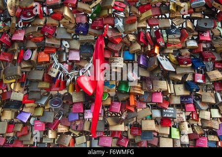 Love locks on Hohenzollern bridge, Cologne, Rhine river, North Rhine-Westphalia, Germany - Stock Photo