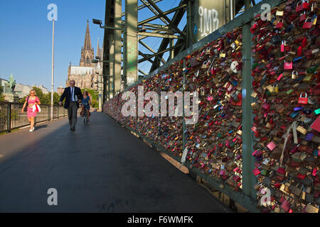 Love locks on Hohenzollern bridge, view to Cologne cathedral, Cologne, Rhine river, North Rhine-Westphalia, Germany - Stock Photo