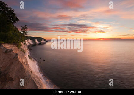 Chalk cliffs at sunrise, Jasmund National Park, Ruegen island, Baltic Sea, Mecklenburg Western-Pomerania, Germany - Stock Photo