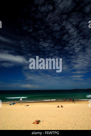 View of Bondi Beach, Australia. Golden sandy beach with blue sky and light cloud. - Stock Photo
