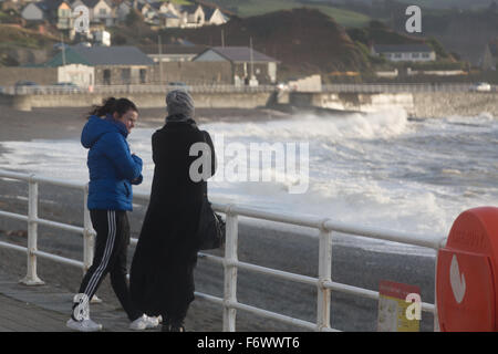 Aberystwyth Wales UK 20th November 2015.  two pedestrians stand in the cold wind on the promenade Credit:  Ian Jones/Alamy - Stock Photo
