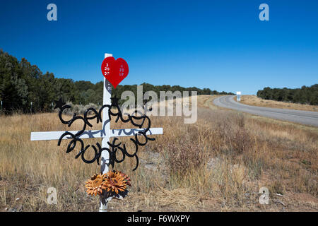 Tres Piedras, New Mexico - A roadside memorial for the victim of a traffic accident. - Stock Photo
