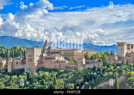 GRANADA ANDALUCIA SPAIN THE ALHAMBRA WITH STORM CLOUDS OVER THE SIERRA NEVADA - Stock Photo
