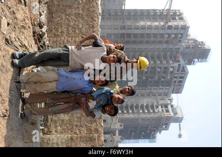 construction workers kids who live in makeshift  dwellings adjacent to the luxury apartment construction sites where - Stock Photo