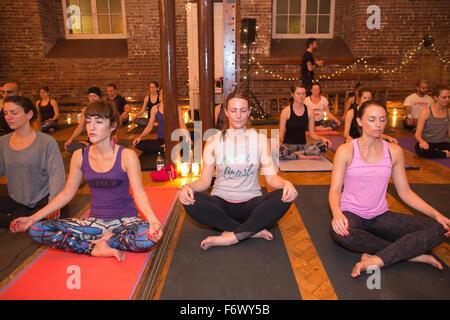Candlelit yoga class, Central London, England, UK - Stock Photo