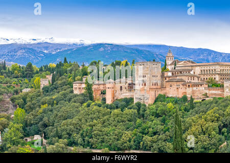 GRANADA SPAIN THE ALHAMBRA A MOORISH CITADEL AND PALACE IN AUTUMN WITH SNOW ON THE SIERRA NEVADA MOUNTAINS - Stock Photo