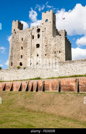 Rochester, English medieval castle. Dry moat with later brick wall and behind that, the outer curtain wall. Background, - Stock Photo