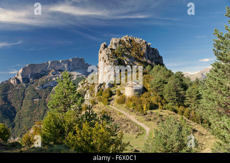 Nice view on high mountains and romanesque chapel in Tella village Sobrarbe county Huesca Aragon Spain. Tella village. - Stock Photo