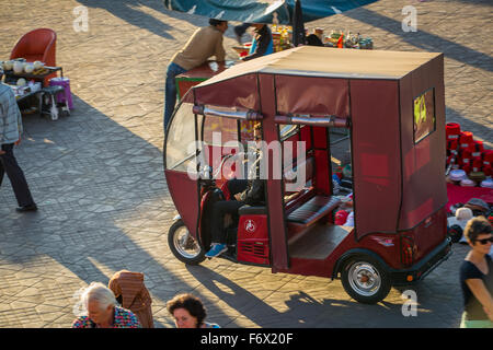 Taxi on the square Jamaa el Fna in Marrakesh - Stock Photo