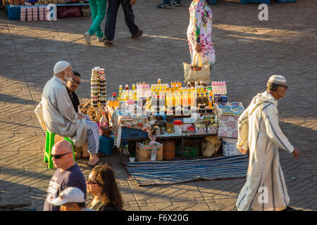 Traditional sale on the square Jamaa el Fna in Marrakesh - Stock Photo