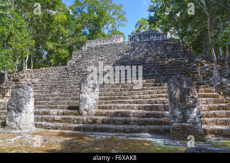 Stela 88 on stairway of Structure 13, Calakmul Mayan archaeological site; Campeche, Mexico - Stock Photo