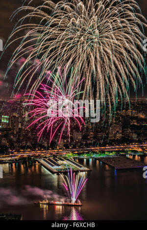 Fourth of July Macy's fireworks over the East River; New York City, New York, United States of America - Stock Photo