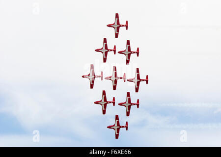 Red demonstration military jet in diamond formation; Lethbridge, Alberta, Canada - Stock Photo