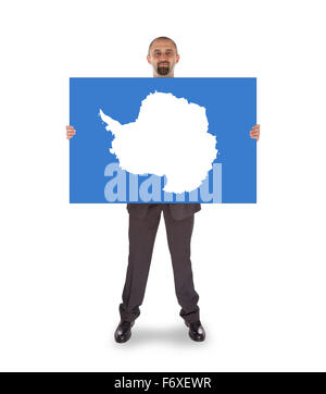 Smiling businessman holding a big card, flag of Antarctica, isolated on white - Stock Photo