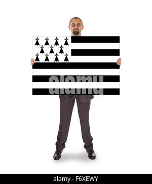 Smiling businessman holding a big card, flag of Brittany, isolated on white - Stock Photo