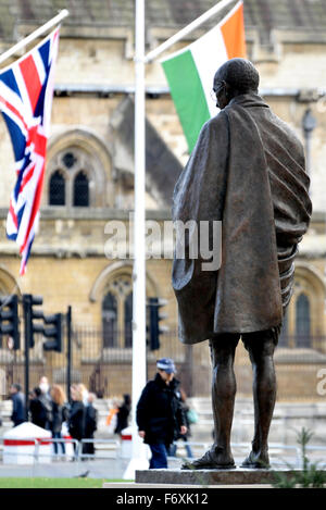 London, England, UK. Statue of Mahatma Gandhi, Parliament Square. (2015: Philip Jackson) with Indian and British - Stock Photo