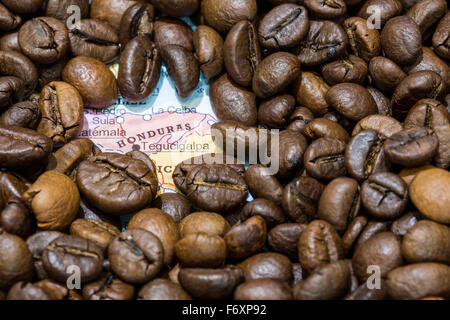 Geographical map of Honduras covered by a background of roasted coffee beans. This nation is between the ten main - Stock Photo