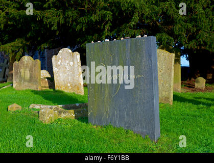 Film-maker Derek Jarman's gravestone in the churchyard of St Clement Church, Old Romney, Romney Marsh, Kent, England - Stock Photo