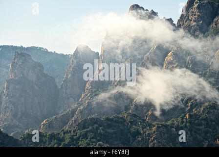 Corsica clouds over the mountains - Stock Photo