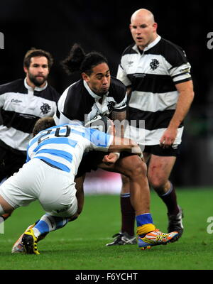 Twickenham, UK. 21st Nov, 2015. Joe Tomane of Barbarians tackled during the Killik Cup between Barbarians and Argentina - Stock Photo