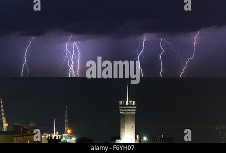 lightnings over the port of Genoa on a stormy night - Stock Photo