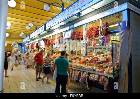 Shoppers at fruits and vegetables stalls in Great Market Hall, Budapest, Hungary. - Stock Photo