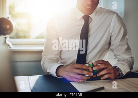 Business man getting ideas at his desk and solving problems - Stock Photo