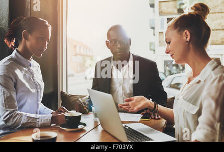 Group of multi ethnic business people at a meeting, small business entrepreneur concept