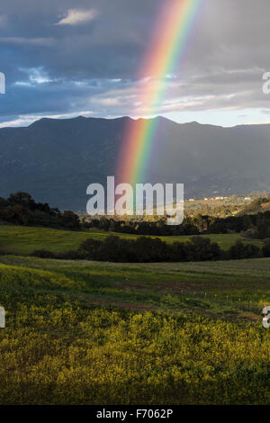 Oak View, California, USA, March 1, 2015, full rainbow over rain storm in Ojai Valley - Stock Photo