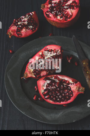 Pieces and grains of ripe pomegranate fruit - Stock Photo