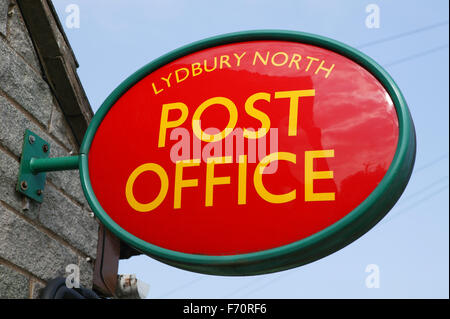 Sign on side of post office, Lydbury North, UK - Stock Photo