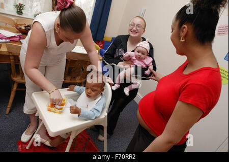 Pregnant young woman with her friends and their babies, - Stock Photo
