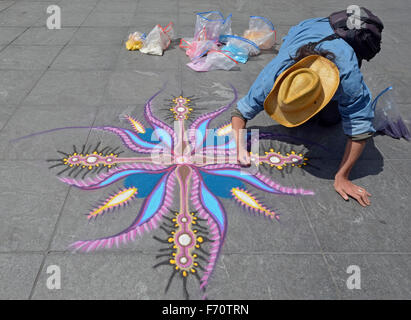 April 2012 Joe Mangrum painting with sand in Washington Square Park in Greenwich Village, NYC - Stock Photo