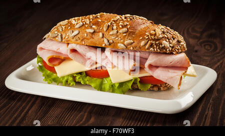 Ham sandwich on wooden background - Stock Photo