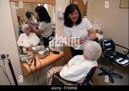Older Woman In Hair Salon Having Hair Cut And Styled By