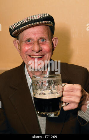 Man drinking a print of beer, - Stock Photo