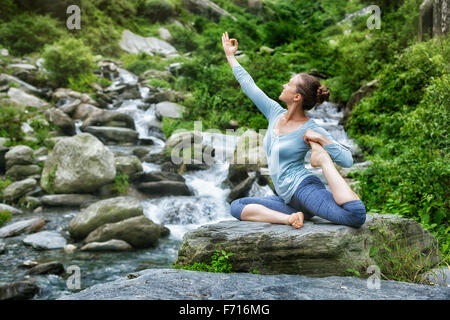 Sorty fit woman doing yoga asana outdoors - Stock Photo