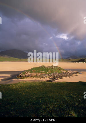 Dun Borranish, a ruined Iron Age dun on the edge of Uig Sands, Lewis, with rainbow and stormy sky. Isle of lewis, - Stock Photo
