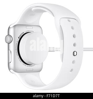 Varna, Bulgaria - October 16, 2015: Charging of Apple Watch Sport 42mm Silver Aluminum Case with White Sport Band. - Stock Photo