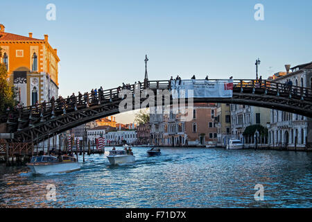 Italy, Venice, Grande Canale, Ponte Academia bridge, motor boats and grand riverside houses - Stock Photo