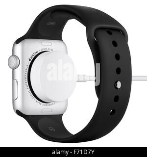 Varna, Bulgaria - October 16, 2015: Charging of Apple Watch Sport 42mm Silver Aluminum Case with Black Sport Band. - Stock Photo