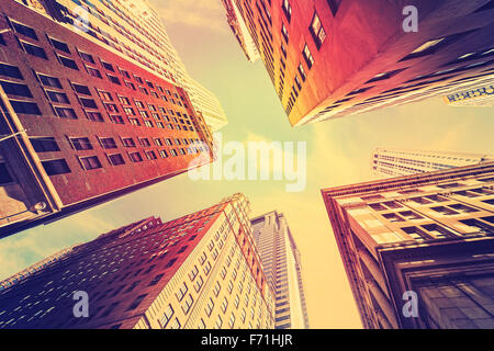 Vintage toned skyscrapers in Manhattan at sunset, New York City, USA. - Stock Photo