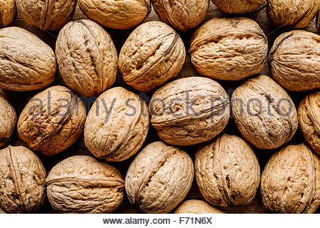 Whole dried walnuts as background - Stock Photo