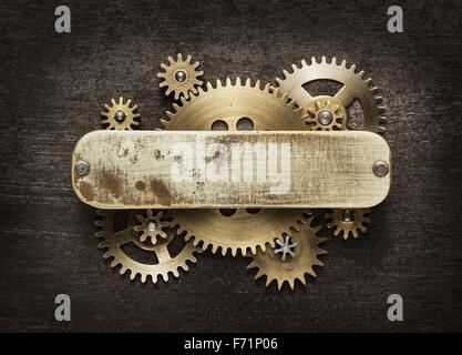 Clockwork mechanism background made of metal gears and brass plate. - Stock Photo