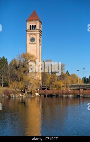 WA12107-00...WASHINGTON - The Clock Tower reflecting in the Spokane River in Spokane's Riverfront Park. - Stock Photo