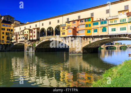 Ponte Vecchio over Arno river in Florence, Italy - Stock Photo