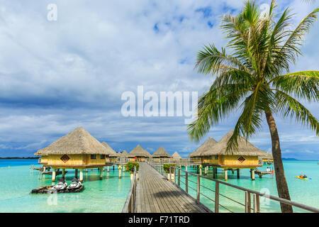 Overwater Bungalows Bora Bora island, French Polynesia - Stock Photo