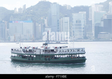 hong kong star ferry on victoria harbor - Stock Photo
