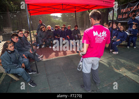 Briefing before a paintballing game between teenagers.  Directions, schooling, instructor, tutor, course, lesson, - Stock Photo